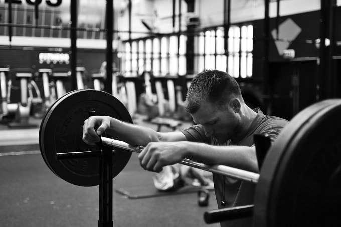 Man In Gym Looking Depressed