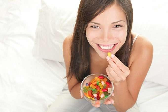Young Woman Eating CBD Gummies